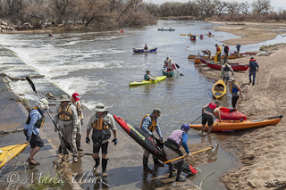 portaging kayaks and canoes over diversion dam on South Platte River