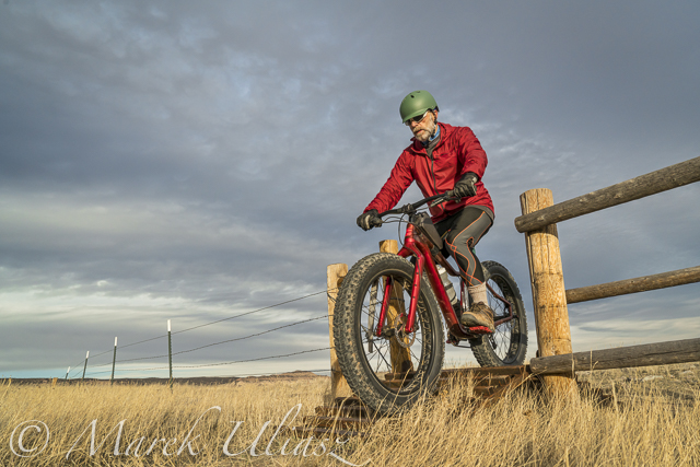 riding a mountain fat bike over a cattle guard